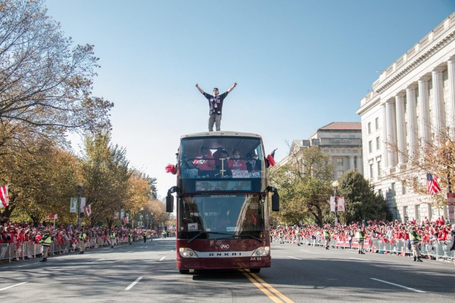 Nationals+pitcher+Max+Scherzer+stands+atop+of+the+bus+driving+down+Constitution+Avenue+during+the+championship+parade+on+Nov.+2+to+celebrate+the+Nationals+winning+the+World+Series.+Scherzer+had+3-0+postseason+record+during+the+2019+season.+Photo+credit%3A+Logan+Bik