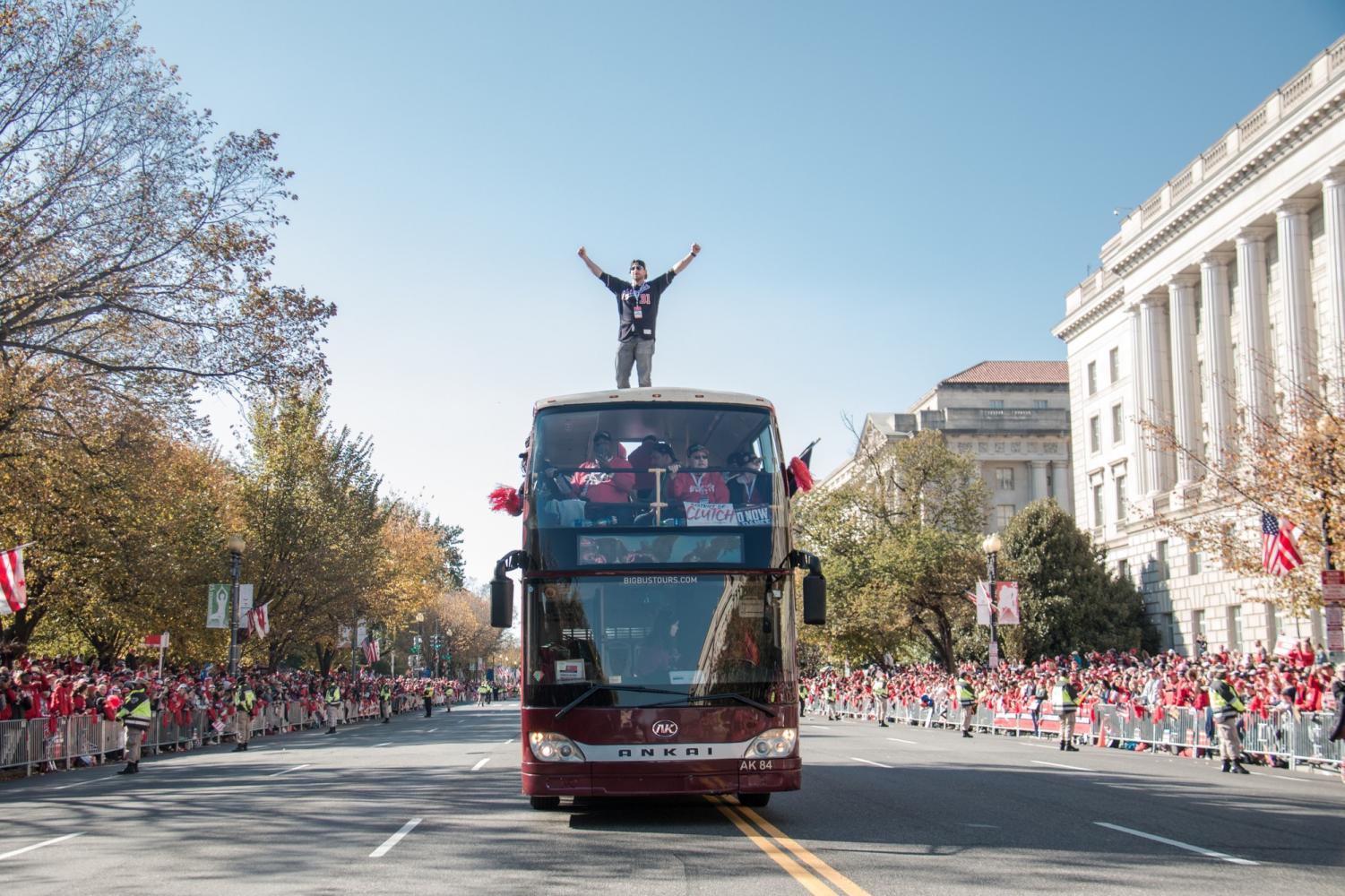 Nationals pitcher Max Scherzer stands atop of the bus driving down Constitution Avenue during the championship parade on Nov. 2 to celebrate the Nationals winning the World Series. Scherzer had 3-0 postseason record during the 2019 season. Photo credit: Logan Bik