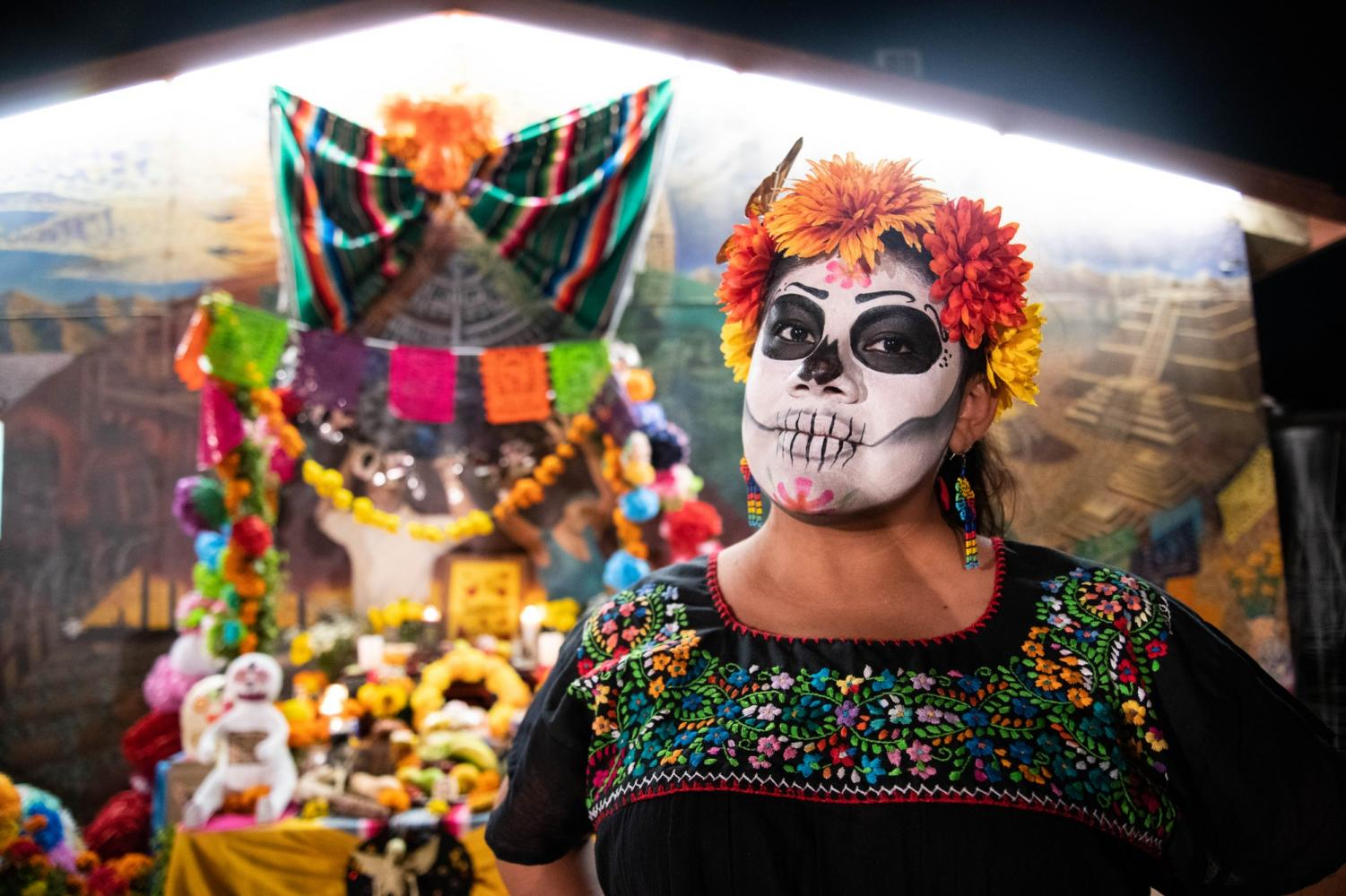 Yesica Catalan celebrates Noche de Ofrenda event at  the Chicano House at CSUN on October 31, 2019 in Northridge, Calif. Photo credit: Sonia Gurrola