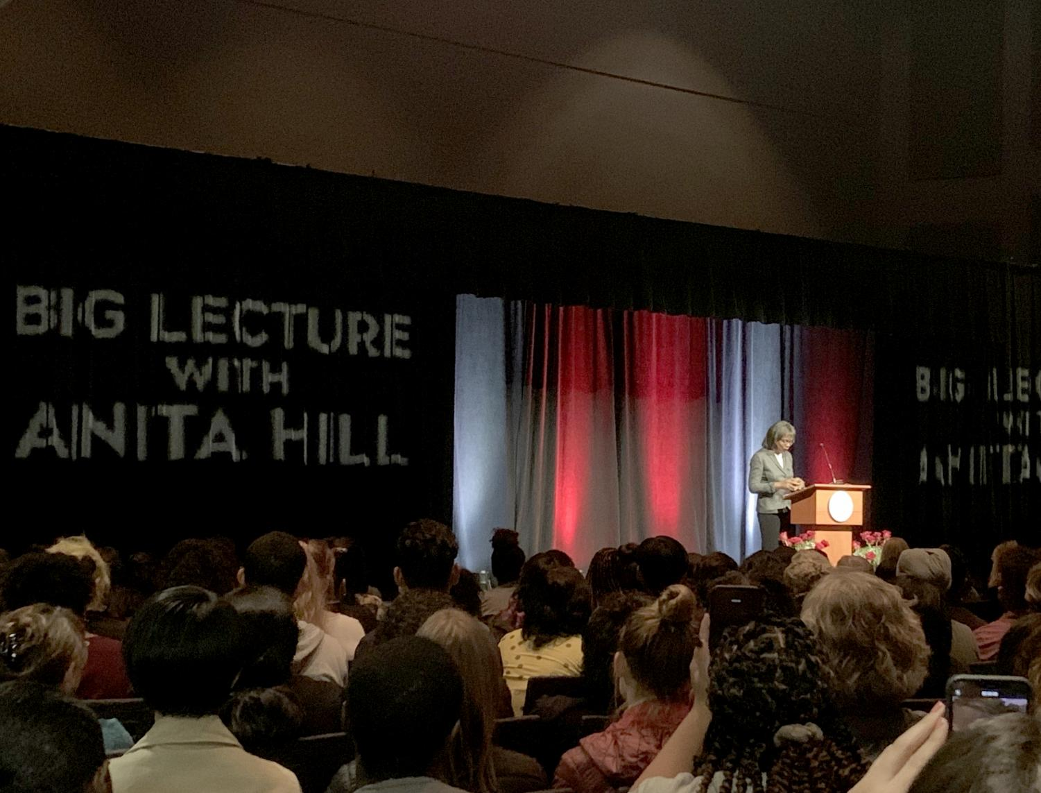Students and faculty watch as Anita Hill shares her story during the