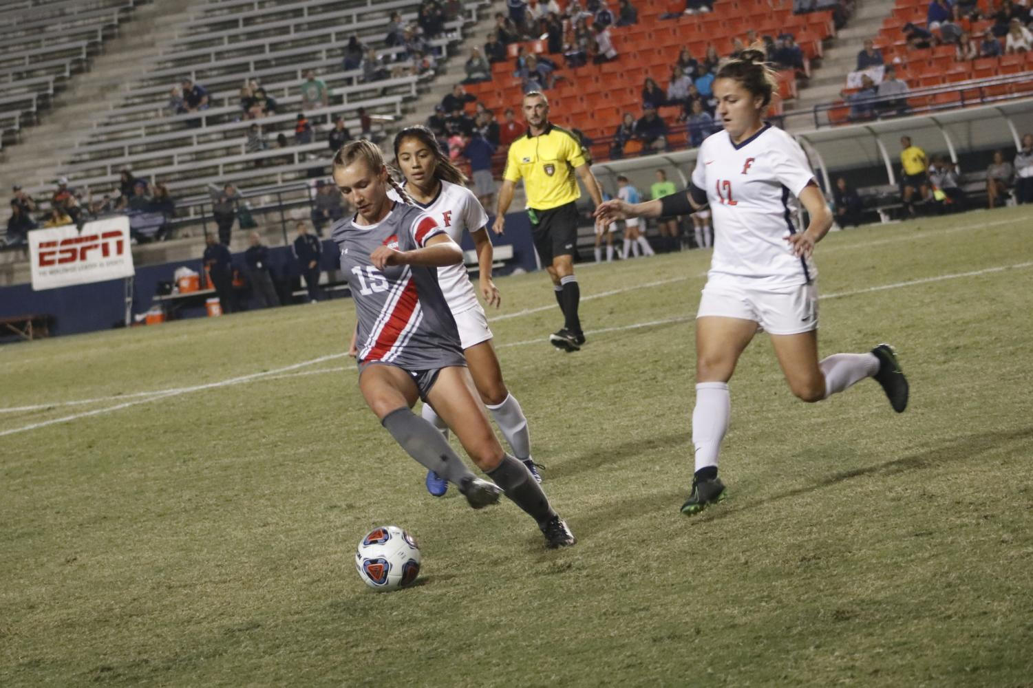 CSUN midfielder Kiley Voss (15) takes the ball to midfield during the Big West Championship game at Titan Stadium on Nov. 10. Photo credit: Karma Singh