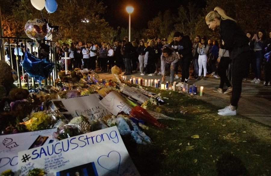 Students+gather+around+the+memorial%2C+which+circled+around+the+flagpole%2C+on+Nov.+17+at+Central+Park+in+Saugus+to+place+candles+and+other+memorabilia+in+support+of+the+community+and+the+deceased+after+the+shooting+two+days+prior.+Photo+credit%3A+Shae+Hammond