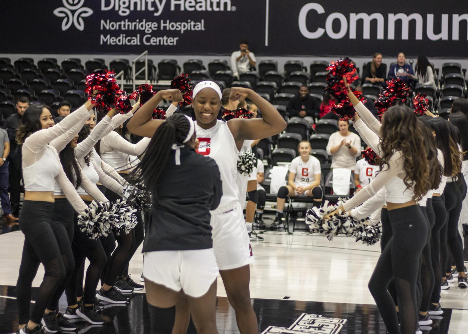 Redshirt senior De'Jionae Calloway walks down the tunnel of cheerleaders during the pregame celebration of the women's basketball exhibition game against The Master's University on Oct. 29. Photo credit: Tim Strong