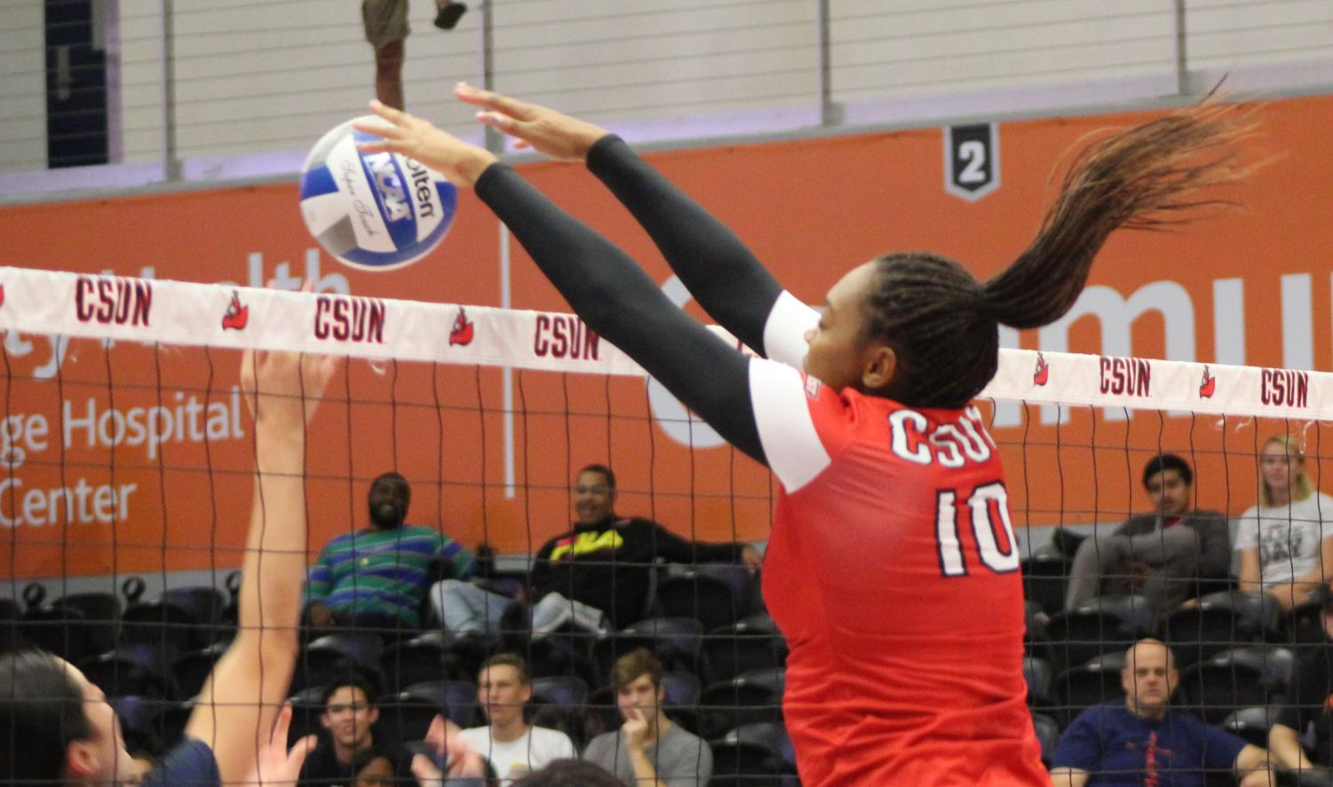 Morgan Salone blocks a ball against Cal State Fullerton in the Matadome on Oct. 19 Photo credit: Serena Christie