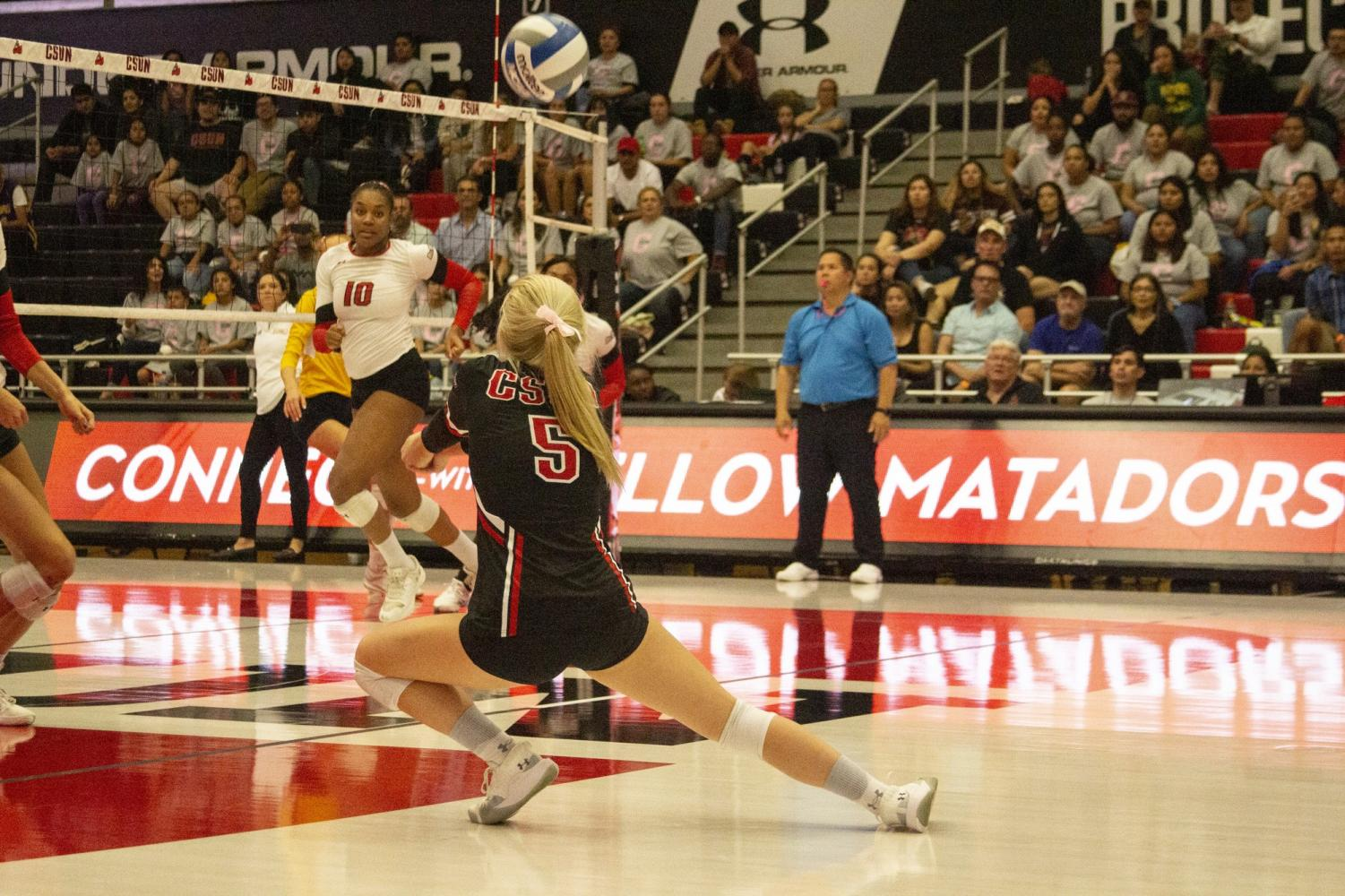 Makayla Bradford (5) digs the ball during a match against UC Irvine on Oct. 18. Photo credit: Serena Christie