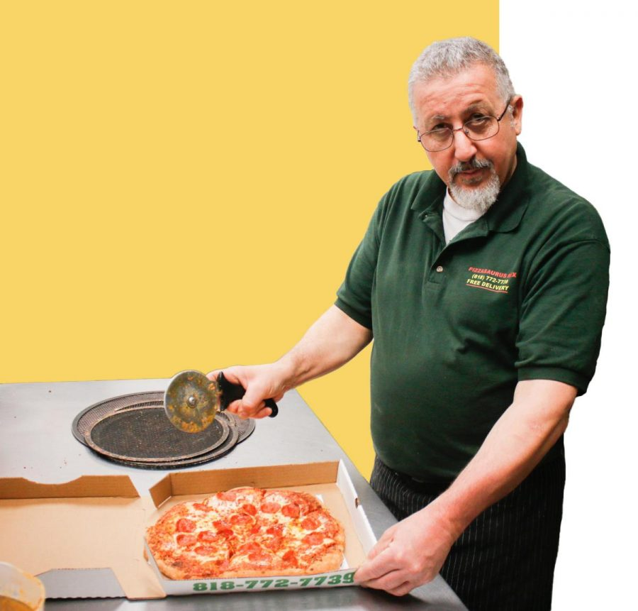 man cutting pizza