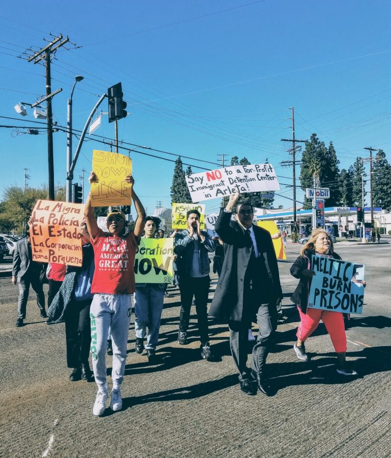 Protesters+walk+down+Nordhoff+Street+and+Woodman+Avenue%2C+crossroads+in+the+city+of+Arleta%2C+where+VisionQuest+is+set+to+open+a+migrant+children%27s+detention+center.+Photo+credit%3A+Ivan+Salinas