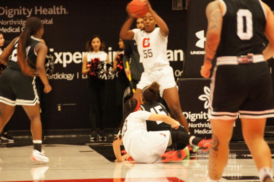 A+CSUN+Women%27s+Basketball+Player+holding+the+ball