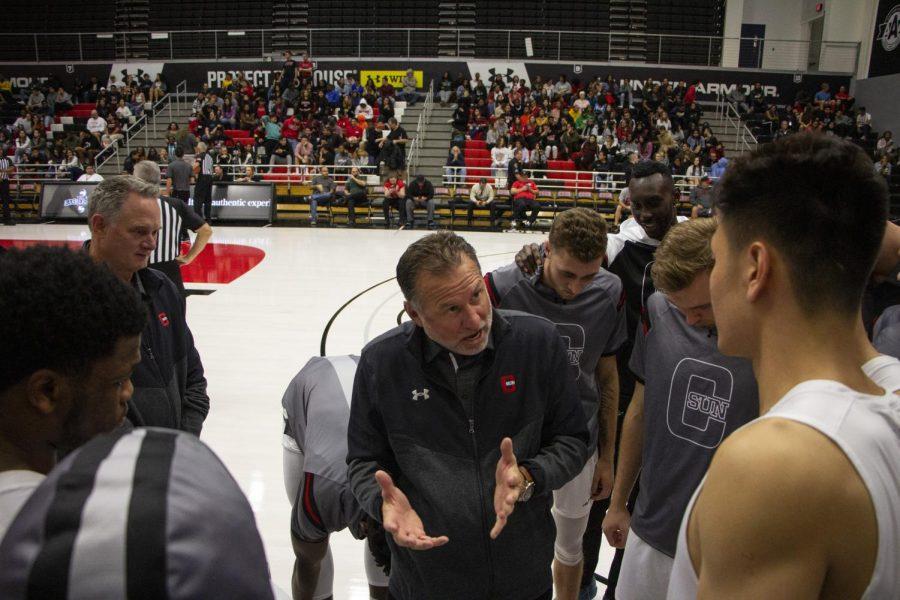 CSUN+Men%27s+Basketball+Team+during+timeout