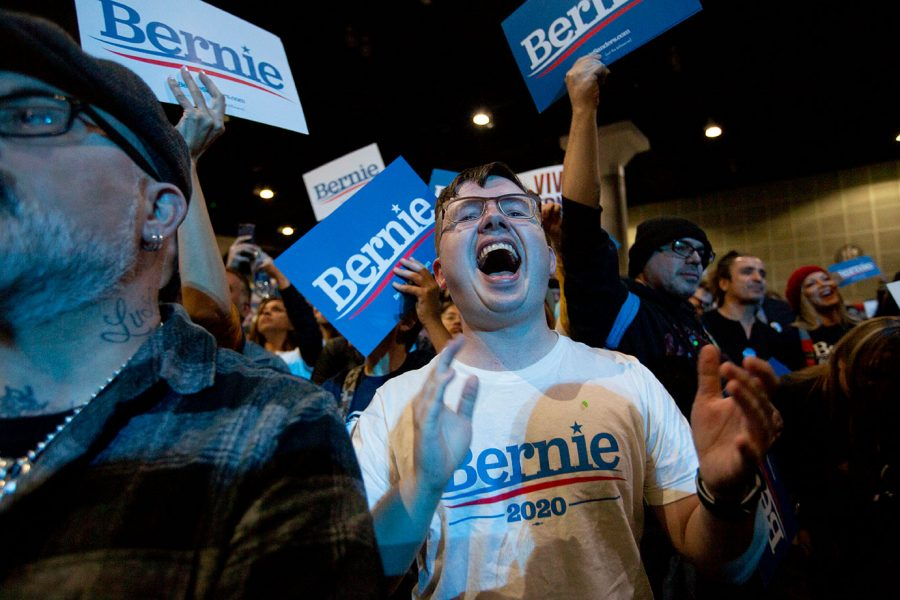 Bernie+supporters+cheer+as+Sanders+speaks+on+stage+at+the+Los+Angeles+Convention+Center.
