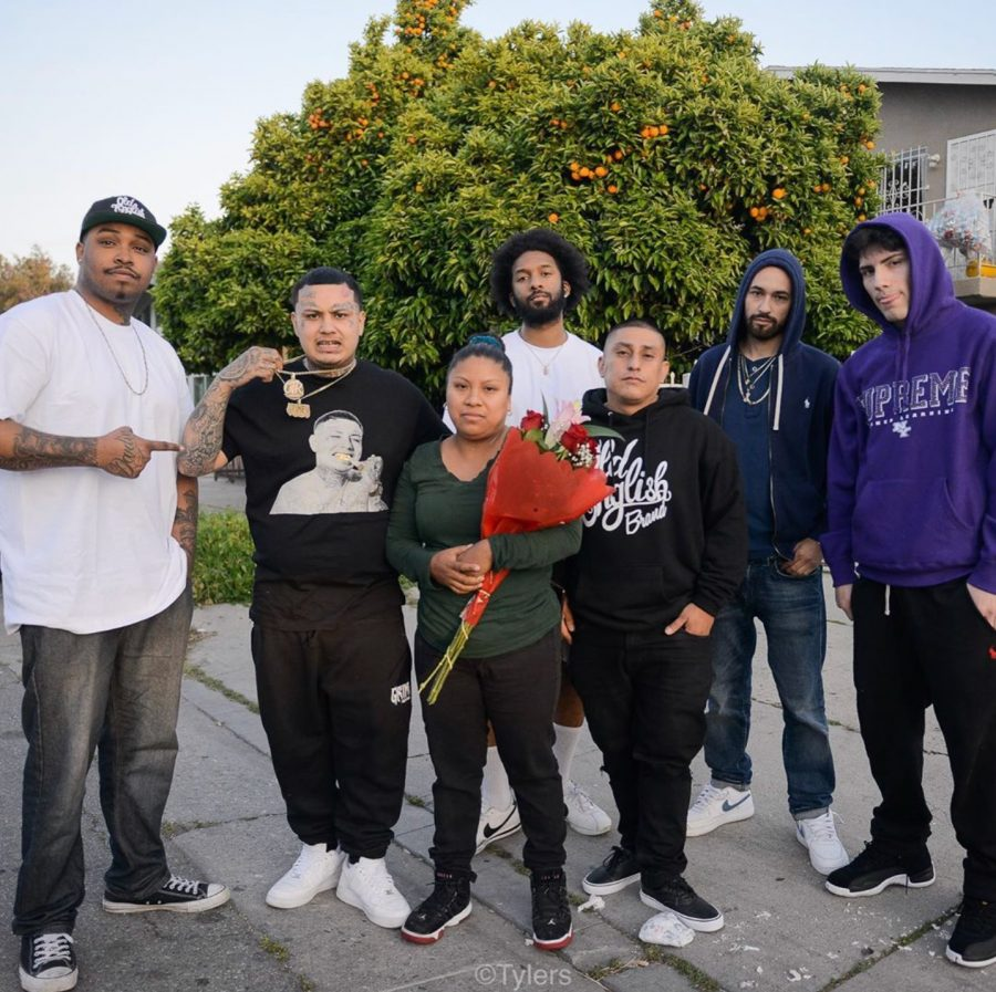 From left to right: El Memo Blaxicano, Swifty Blue, Kissed Killed (in the back) Lucia Guerrero, Jimmy Diaz, and V Lok met up with Lucia Guerrero across from a police station, standing in solidarity with her after her shop was robbed.