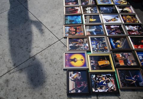Fans lay out photographs of Kobe Bryant throughout his career outside The Staples Center days after he died in a helicopter crash.