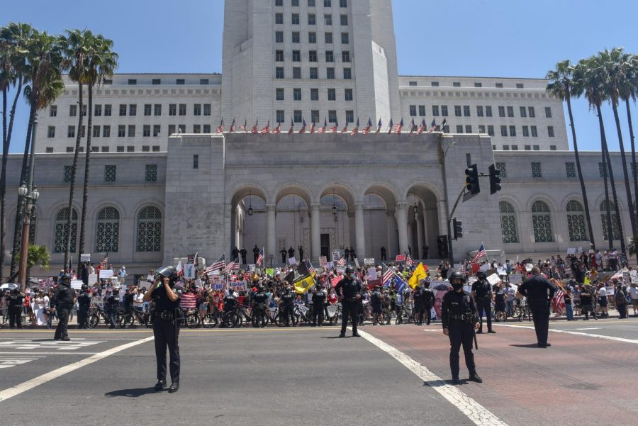 Protestors+from+the+group+Open+California+line+up+outside+of+City+Hall+in+an+effort+to+open+California%27s+economy.