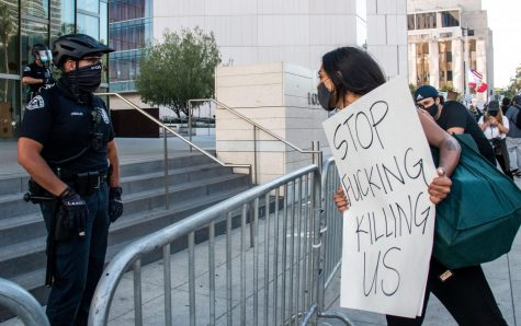 Protesters outside of the LAPD headquarters demand justice for George Floyd on Thursday.