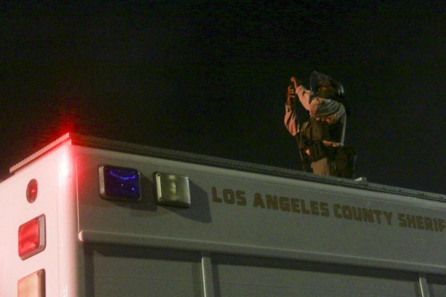 L.A. County Sheriff takes a photo of the aftermath.