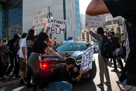 Protesters block a CHP vehicle as it drives past the LAPD headquarters on Thursday.