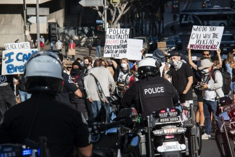 Police block off protesters as they attempt to enter the freeway on Friday.