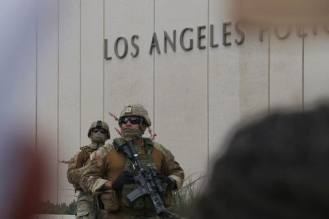 The National Guard stands outside of the LAPD headquarters in downtown L.A.