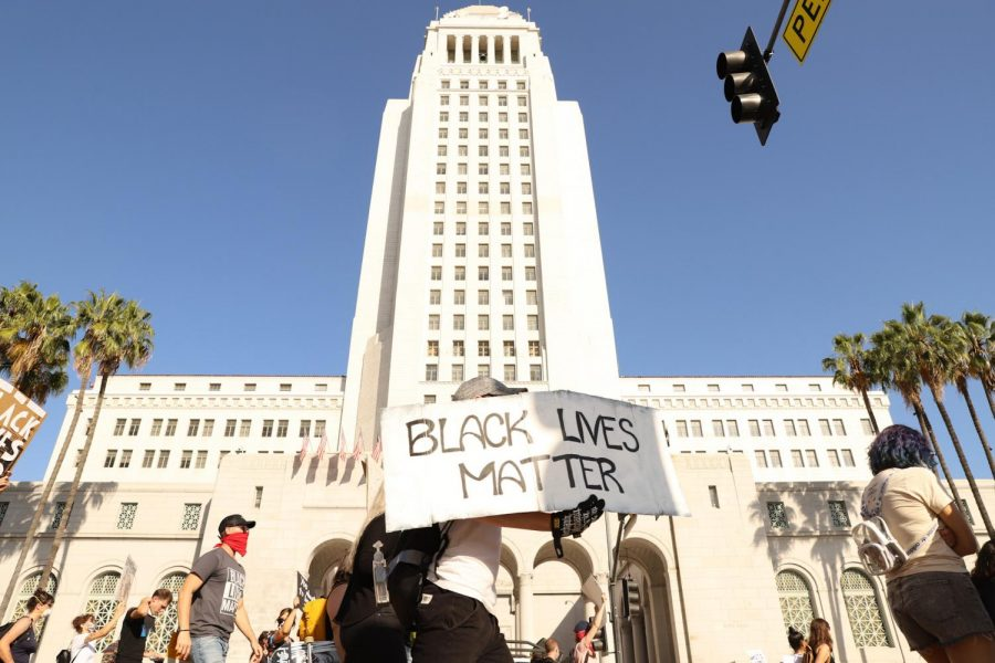Protesters march past L.A. City Hall on June 17, 2020.