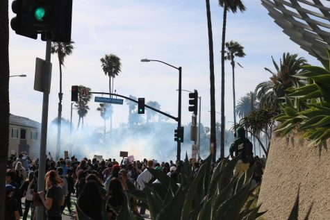 As protesters linger past curfew, police launched tear gas in hopes to disperse the crowd.