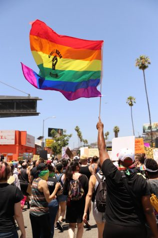 Hundreds of protesters march during the