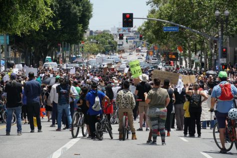 Crowds gather on the streets of downtown Los Angeles to commemorate George Floyd.