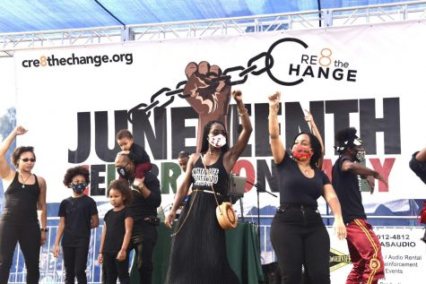 Families and Cre8 The Change dancers enjoy music on stage during the Juneteenth Celebration Rally in Van Nuys Sherman Oaks Memorial War Park on Friday, June 19, 2020.