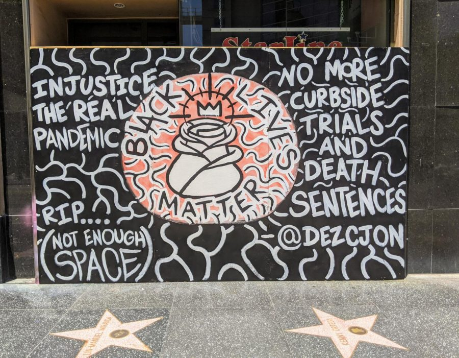 Dezcjon+Lathrop%27s+mural%2C+outside+of+the+Hollywood+Pantages+Theater.