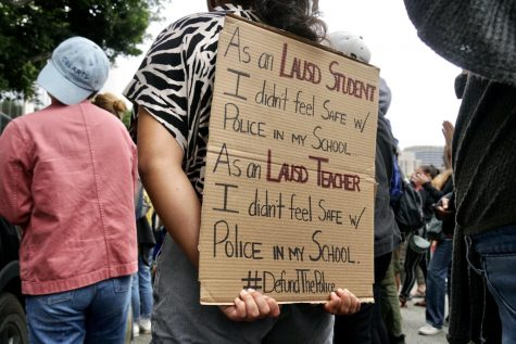 A protester holds a sign during a