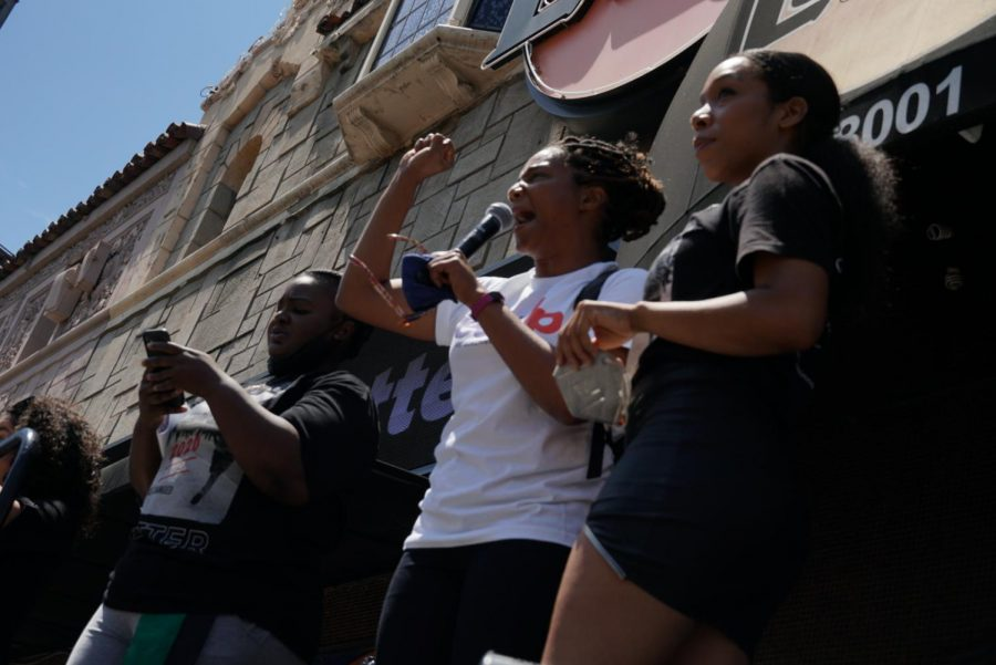 Comedian and actress Tiffany Haddish speaks to demonstrators at the Laugh Factory protest.
