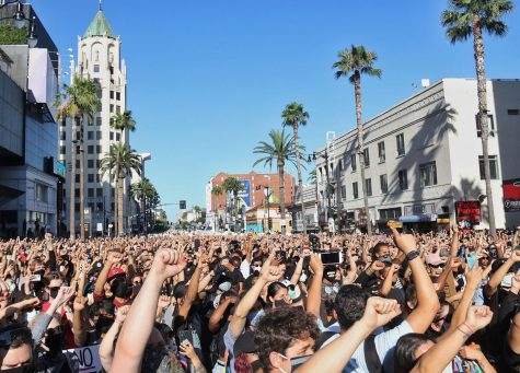 Protesters hold their fists up during the protest on Hollywood Boulevard.