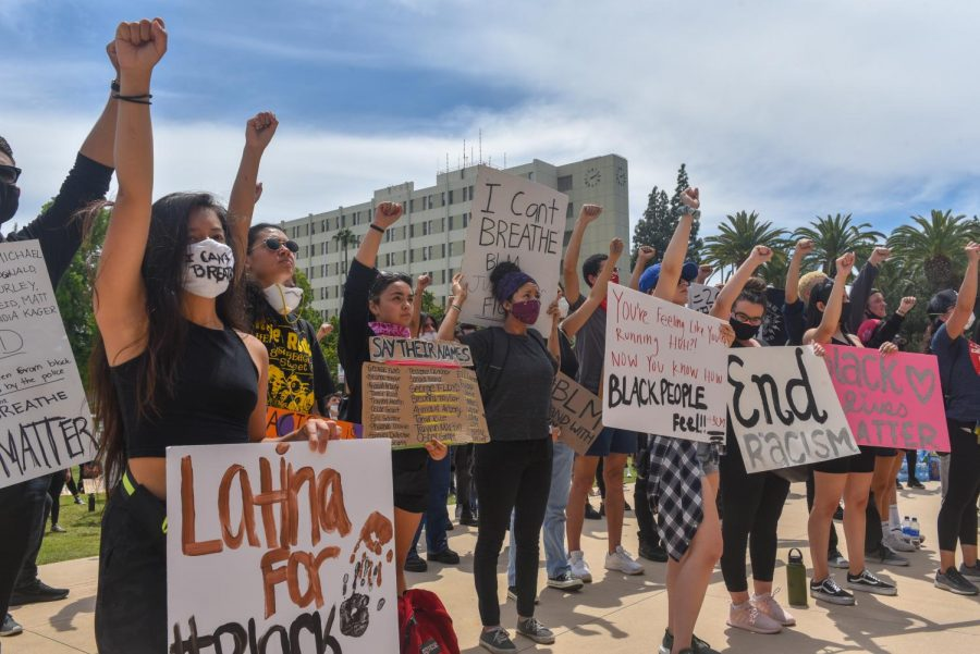 Protesters gathered outside of the Oviatt Library on Tuesday.