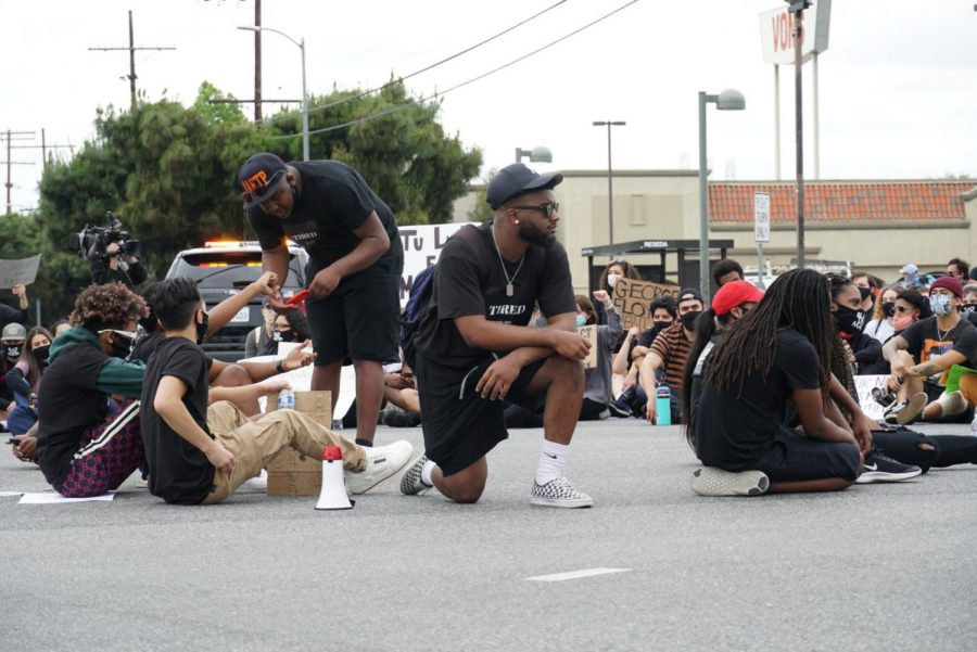 Protesters take a knee with Northridge Black Lives Matter in the Reseda and Nordhoff intersection.