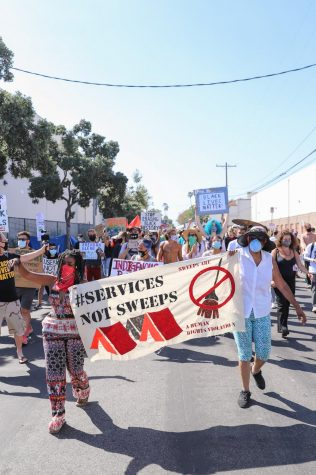 "Protesters march for Black Unhoused lives during the ""Defund the Police: Rally for Black Unhoused Lives"" in Venice, California, on Sunday, July 5, 2020."
