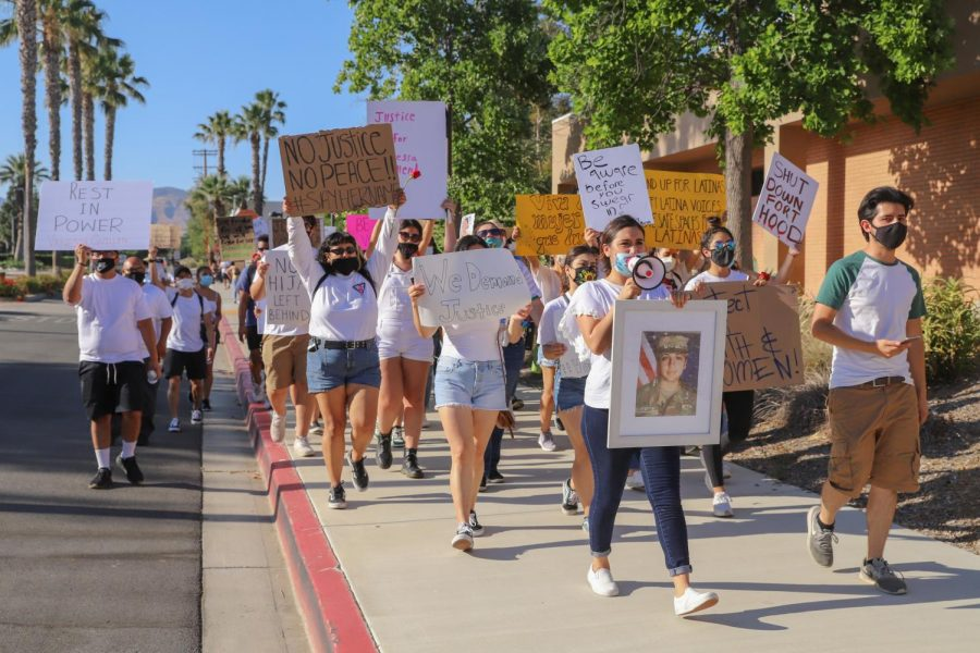 Protesters, led by protest organizers Maria Christina Medina and Ivan Salínas, marching down Etiwanda Avenue toward Nordhoff Street to bring awareness of Vanessa Guillén's death on Monday, July 6, 2020.