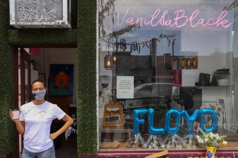 Vanessa Butler, the owner of VanillaBlack, stands at the entrance of the Echo Park coffee shop on Thursday, June 25, 2020. Butler said the coffee shop remained open throughout the pandemic with implemented safety precautions.