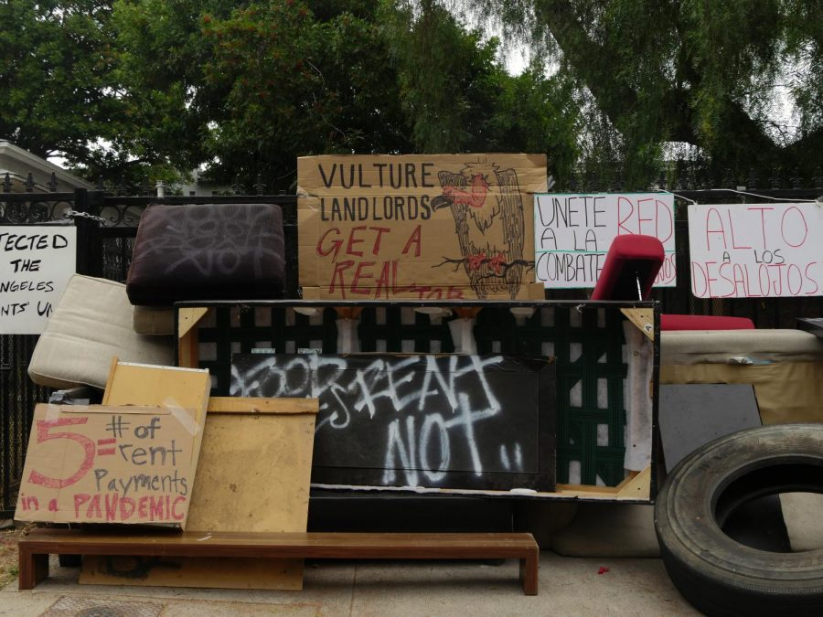 Signs set up by the Los Angeles Tenants' Union members at the residence of Betty Ordaz, who was being illegally evicted.