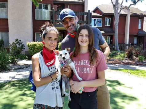 Kellin Esquivel-Gunn, left, John Gunn and Lily Gunn pose with their former foster dog, Madonna.