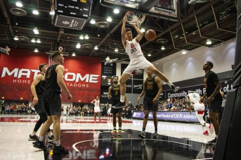 Matador sophomore center Michael Ou slams a dunk during a scrimmage against CSU Dominguez Hills on Oct. 28, 2019.
