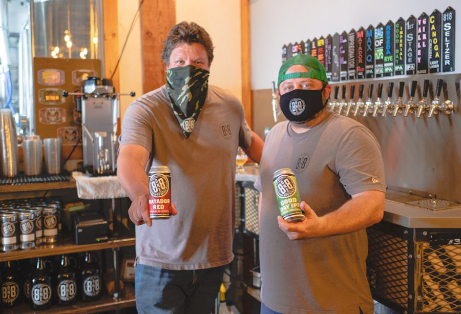 Derrick Olson, left, and Bryan Olson, co-owners of 8one8 Brewing, stands in their shop in Canoga Park, Calif., on Monday, Aug. 31, 2020.