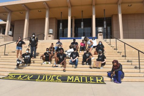 Northridge Black Lives Matter and protesters sitting on the steps of Oviatt Library at the end of their protest on Saturday, Sept. 26, 2020.