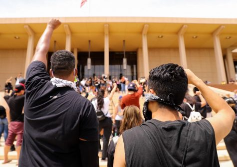 Protestors raise their fists in support of the Northridge Black Lives Matter protest at CSUN in Northridge, Calif., on Tuesday, June 2, 2020. President Harrison sent out an email detailing CSUN