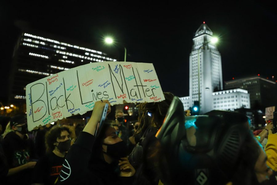Protesters march the streets of downtown Los Angeles to demand justice for the death of Breonna Taylor after the results of a grand jury indictment of former Louisville police officer Brett Hankinson, in Los Angeles, Calif., on Wednesday, Sept. 23, 2020.