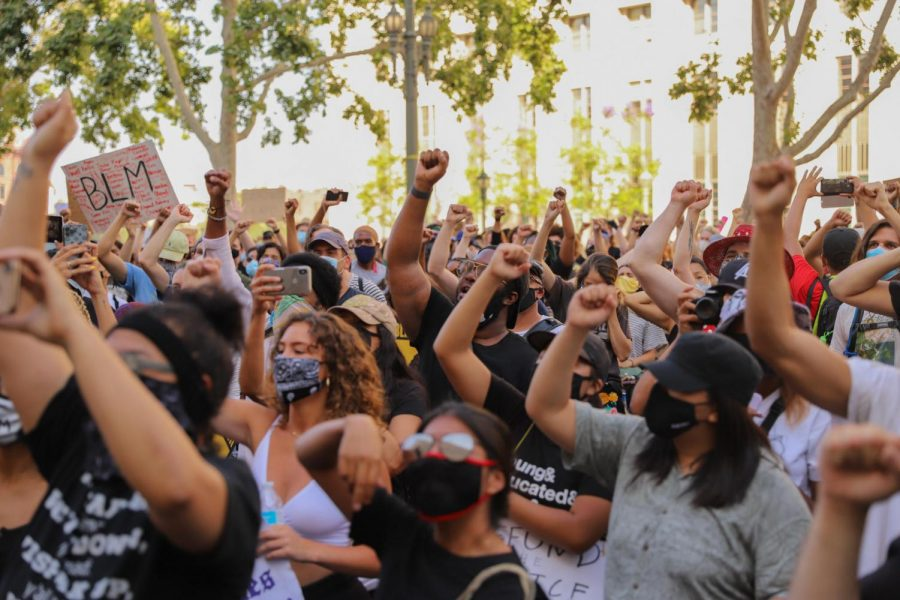 Protestors put their fists up in support of the Black Lives Matter movement during a protest at the Hall of Justice in Los Angeles, Calif., on Friday, June 17, 2020.