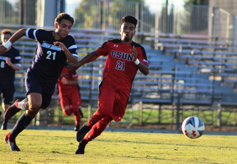 Daniel Trejo aggressively fights for the ball to dribble towards the goal against the University of San Diego on Sept. 23, 2018.