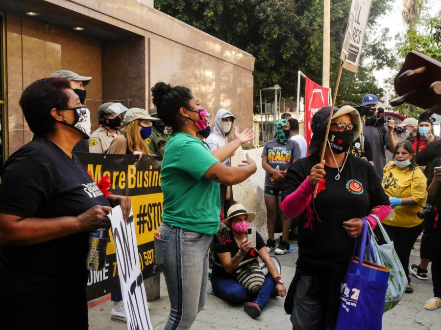 Activists dance outside the Los Angeles Superior Court in downtown L.A. during an eviction blockade on Wednesday, Sept. 2, 2020.