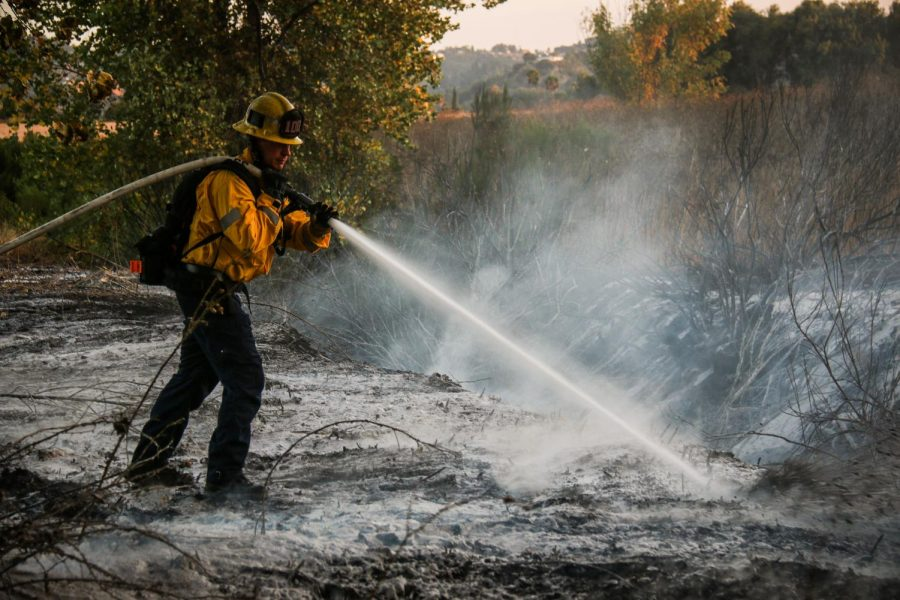 A+firefighter+sprays+chemical+foam+to+stop+the+fire+from+starting+up+again+at+the+Sepulveda+Basin+Wildlife+Reserve+in+Van+Nuys+on+Saturday%2C+Sept.+19%2C+2020.+