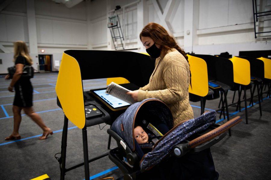 Miranda Martinez votes at the CSUN voting center with her baby, Ezra Martinez on October 30, 2020.