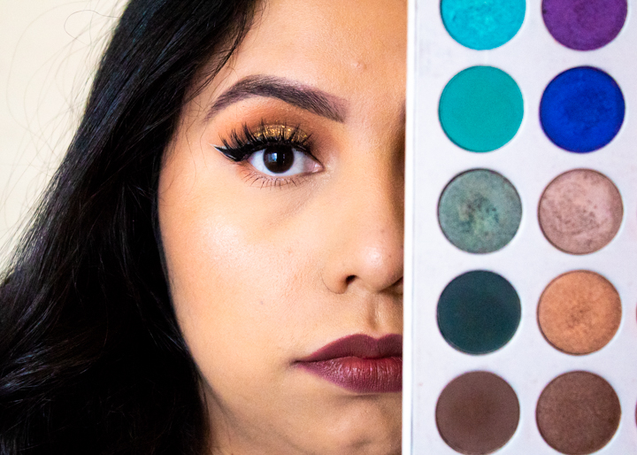 Belen Hernandez, 25, covers half her face with a colorful eyeshadow palette in her North Hollywood, Calif. bedroom on Sept. 15, 2020. Hernandez uses makeup application as a creative outlet while being home during the coronavirus pandemic.