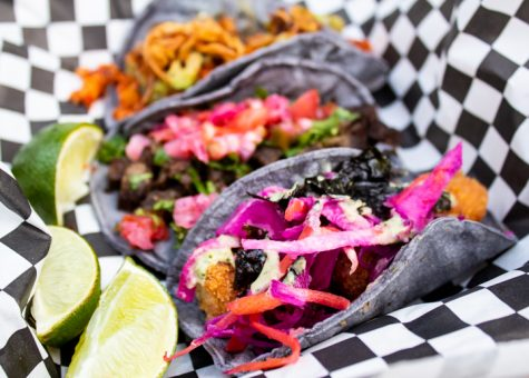 Three vegan tacos, wrapped in blue corn tortillas, in a to-go box from Pacha Taco on Oct. 4, 2020, in Sun Valley, Calif.